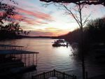 Commercial Marina offered for sale with 8 gas pumps, Lodge and 2 Homes on 900 feet of shoreline of Lake of the Ozarks.