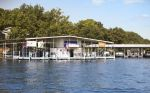 Commercial dock with 20 slips has 8 gas pumps with 900 feet of shoreline on Lake of the Ozarks.